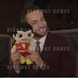 Shazam star, Zachary Levi with his character plush